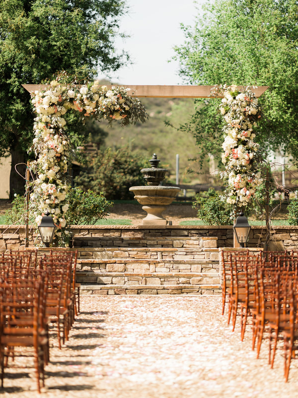 Floral arch with fountain in the background of this private venue.  Perfect for wedding and reception.